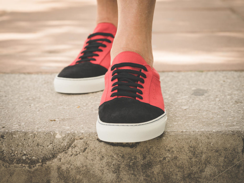 Men's and women's red sneakers
